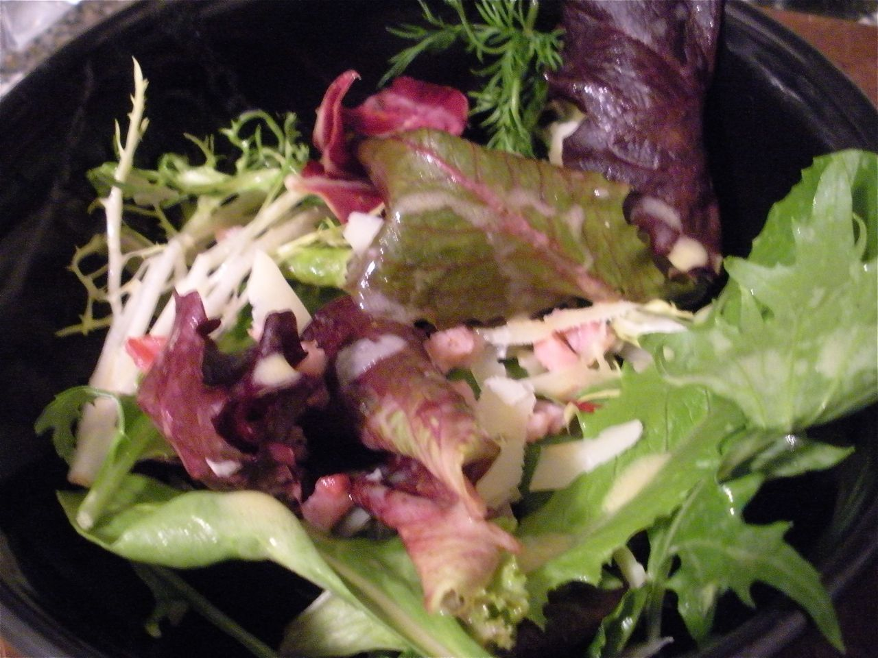 Mixed greens with pancetta and manchego and citrus vodka dressing