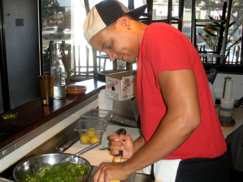 Amir's zesting lemons for the pot pie crust. The juice will be used for the arugula salad.