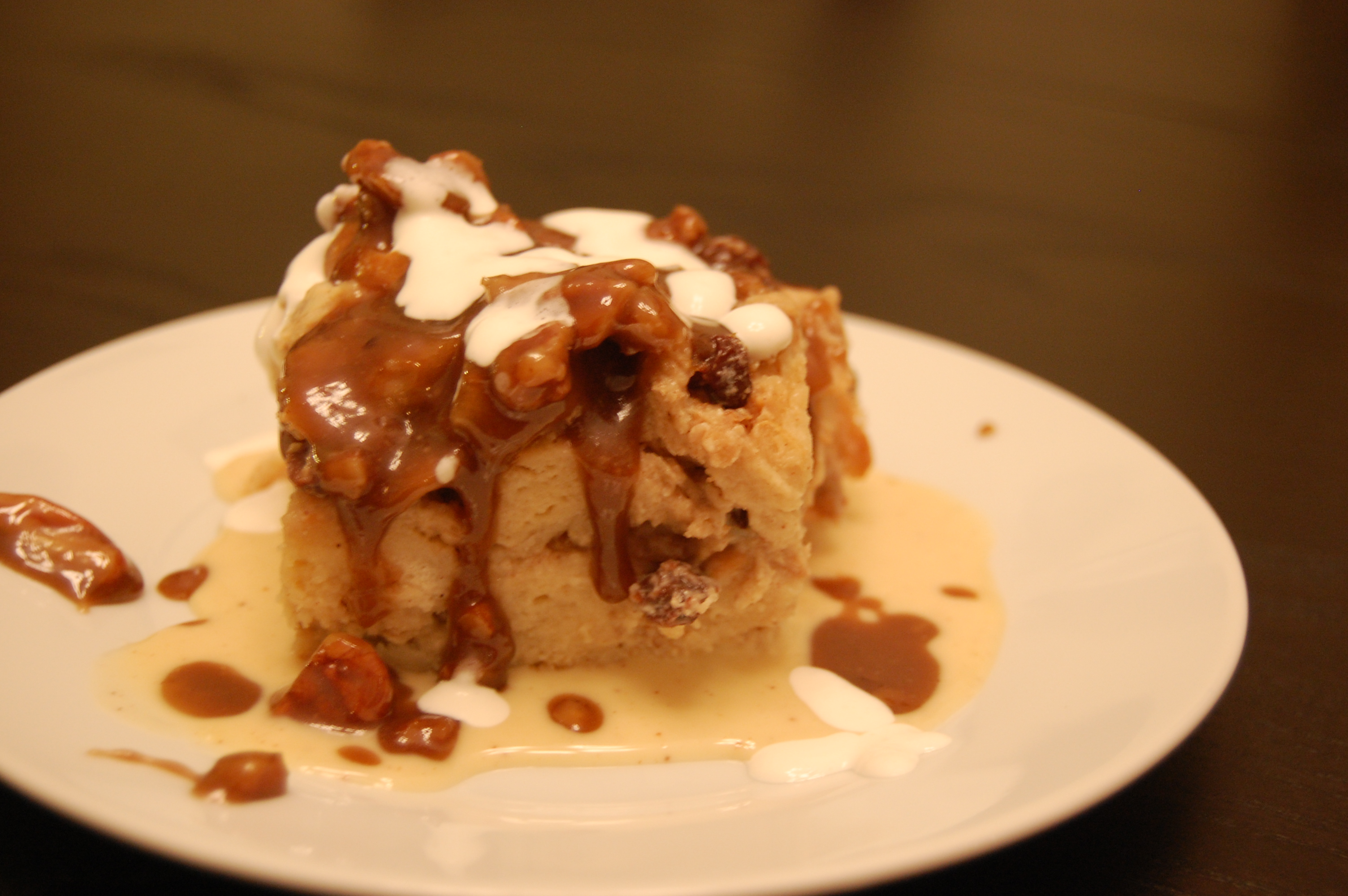 Bananas Fosters Bread Pudding with Custard Sauce and Banana Rum Sauce